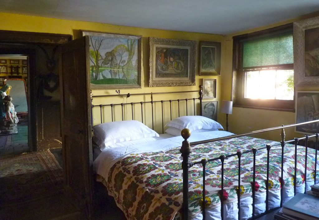 n the top floor back bedroom, a landscape by John Nash, and David Bomberg's self portrait.